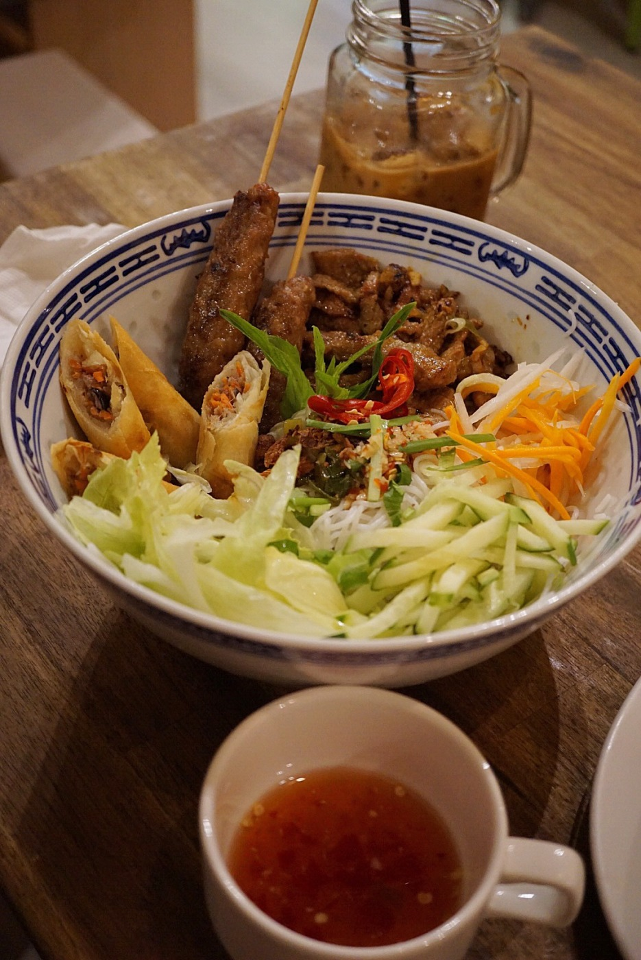 Bun thit nuong cha gio ($14) Pork vermicelli noodles with fresh salad