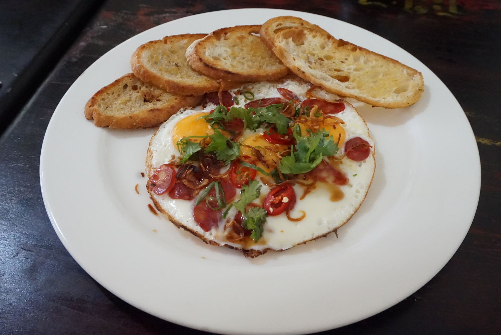 Fried eggs, lap cheong, lime-soy, shallots & bread ($14)