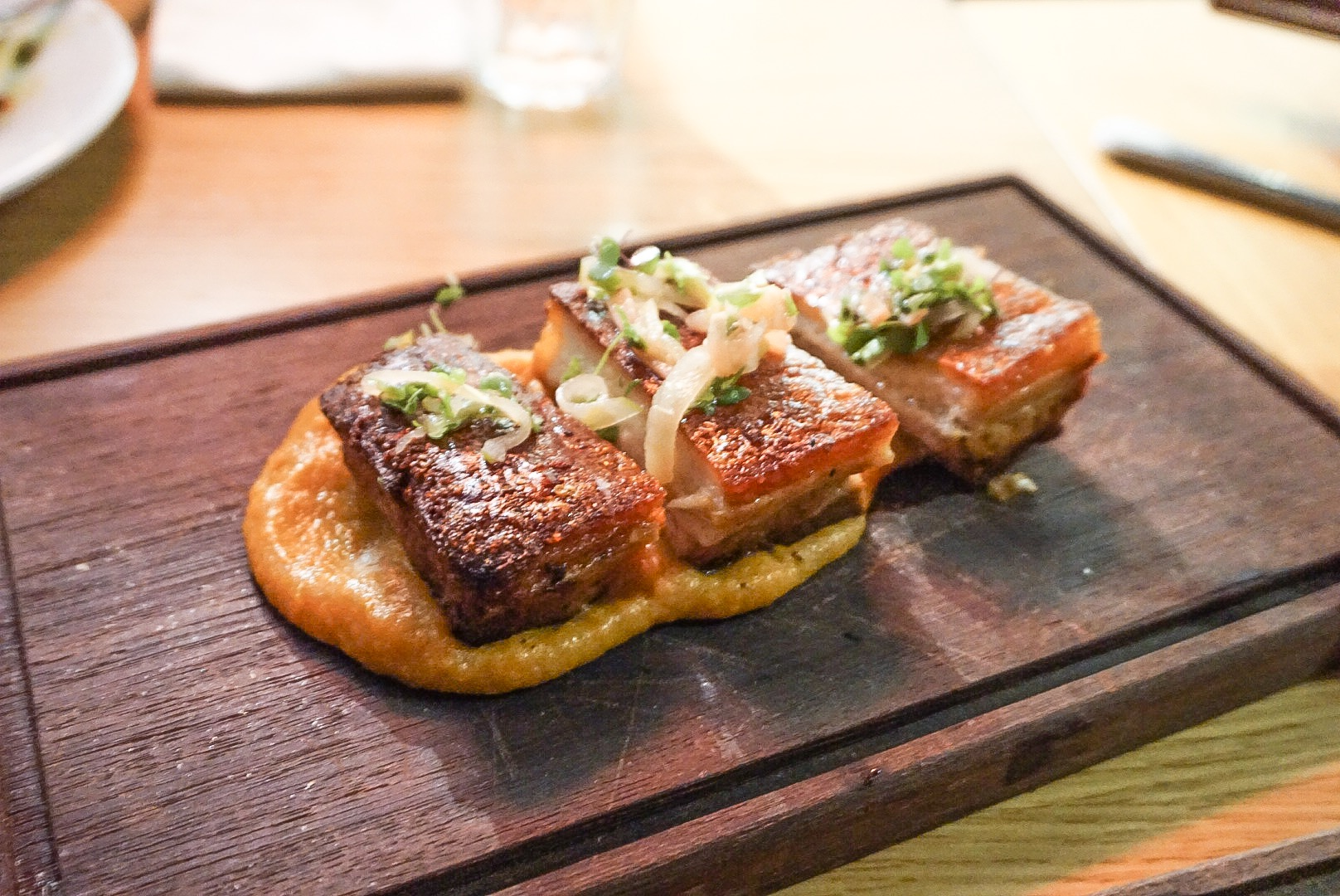 Crispy pork belly, persimmon puree & apple radish pickle ($28)