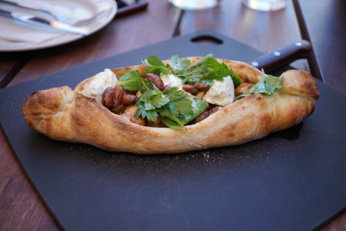 Chicken, paprika, olives, almonds & tahini yoghurt pide ($24)
