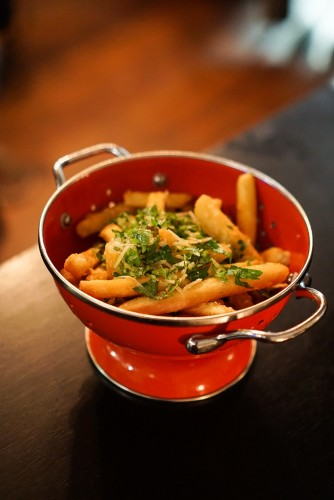 Beer battered chips, truffle oil, parmesan cheese ($10)